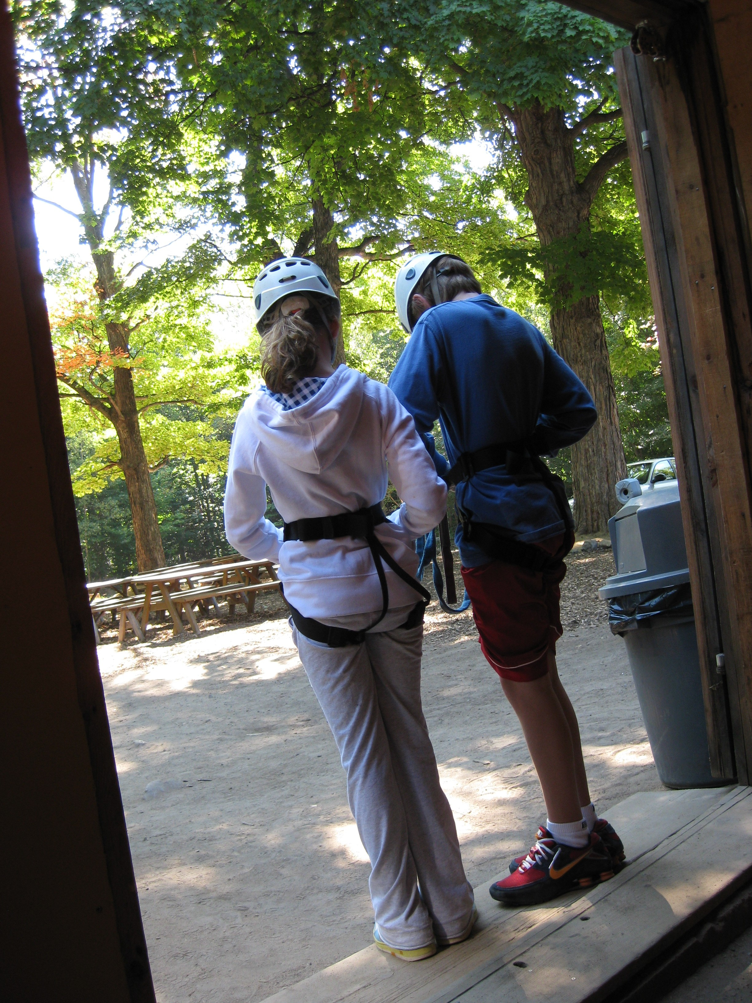 The twiblings prepare for their first ziplining experience.